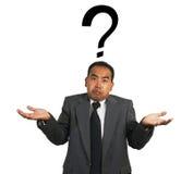 Encolho de ombros do homem de negócio com marca de Quesiton Imagens de Stock