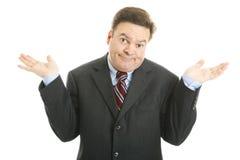 Encolhos de ombros do homem de negócios Fotos de Stock
