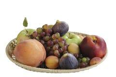 Encore-durée avec des fruits au-dessus de blanc Photos stock