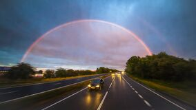 Encounter a double rainbow while driving at high speed