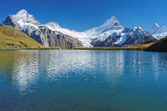 Encountering the Bachalpsee during the famous hiking trail from First to Grindelwald (Bernese Alps, Switzerland). Stock Photography