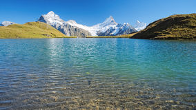 Encountering the Bachalpsee during the famous hiking trail from First to Grindelwald (Bernese Alps, Switzerland). Royalty Free Stock Photography