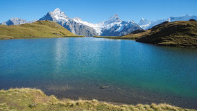 Encountering the Bachalpsee during the famous hiking trail from First to Grindelwald (Bernese Alps, Switzerland). Royalty Free Stock Photo