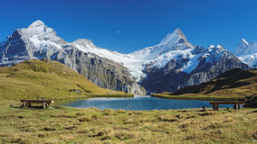 Encountering the Bachalpsee during the famous hiking trail from First to Grindelwald (Bernese Alps, Switzerland). Royalty Free Stock Images