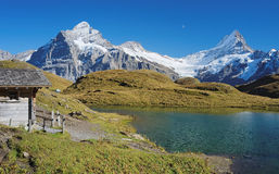 Encountering the Bachalpsee during the famous hiking trail from First to Grindelwald (Bernese Alps, Switzerland). Royalty Free Stock Image