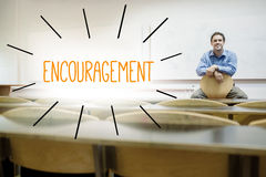Encouragement against lecturer sitting in lecture hall Royalty Free Stock Photos