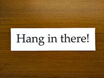 Free Encouragement Concept, The Sentence `Hang In There!` Royalty Free Stock Photos - 191748878