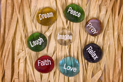 Encouragement And Inspirational Stones. Close up shot of a selection of encouragement and inspirational stones on paper background royalty free stock photography