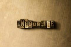 ENCOURAGEZ - le plan rapproché du mot composé par vintage sale sur le contexte en métal illustration libre de droits