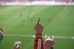 Encouraging. People encouraging their team in a soccer stadion, focus is on the hands Stock Photos