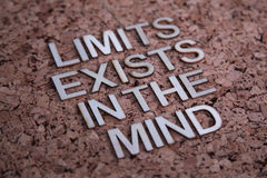 Encouraging words. That says limits exists in the mind with a corkboard background in brown stock images