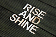 Encouraging words. Wooden letters forming the words Rise and Shine Stock Images