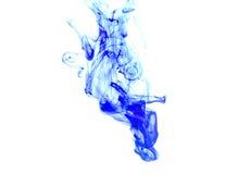 Encre bleue dans l'eau Photographie stock libre de droits