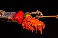 Encre rouge et orange de couleur pour la copie sur le tee-shirt Photographie stock libre de droits