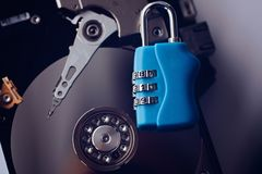 Encrypted hard disk. Padlock with cipher on an opened hard disk. Data loss Royalty Free Stock Photo