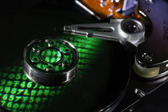 Encrypted hard drive. Selectively focused hard drive closeup reflecting random characters as a concept of encryption, espionage and privacy Stock Photos