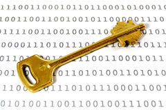 Encryption key. Golden key on a sheet with binary encrypted data Stock Photo