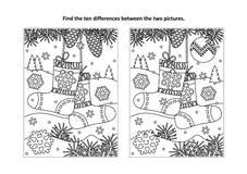 Encuentre la página visual del rompecabezas y del colorante de las diferencias con los calcetines de la Navidad ilustración del vector