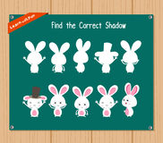 Encuentre la sombra correcta, juego para los niños - conejito de la educación Foto de archivo
