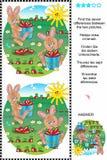 Encuentre las diferencias - los conejitos y las zanahorias Foto de archivo
