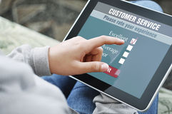 Encuesta sobre en línea la satisfacción del servicio de atención al cliente Fotos de archivo