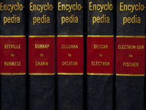 Encyclopedia. 5 volumes from old encyclopedia. Black, Red and Gold stock photography