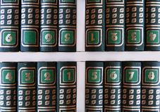 Encyclopedia. Volumes of an encyclopedia disordered Shelf royalty free stock photo