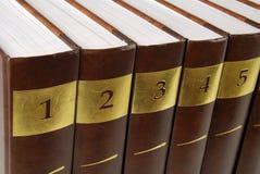 Encyclopedia. Five volumes of encyclopedia - books in a row stock photo