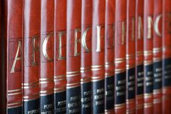 Encyclopedia. Row of encyclopedia books. Focus on volume A Royalty Free Stock Photography