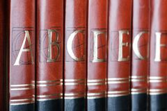 Encyclopedia. Row of encyclopedia books. Focus on volume A Stock Photography
