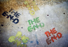 The End. Multiply color The End Sign on the grunge cement pavement stock image