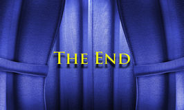 The end. Blue textured curtains closing on the words the end royalty free stock images