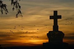 The end. Cross in the sunset Stock Image