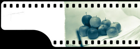 End of analogue film  with frame of apples Royalty Free Stock Images