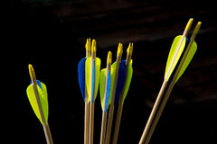 End of arrows. Bunch of yellow and blue archery arrows stock images