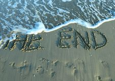 THE END on the beach by the sea while the wave comes Stock Photo