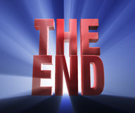 The End. Bold, red THE END on a dark blue background brilliantly backlit with light rays shining through Stock Images