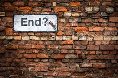 The End Concept Image. Uncertainty Concept Image Of A Grungy Sign Saying End? On An Old Red Brick Wall royalty free stock images