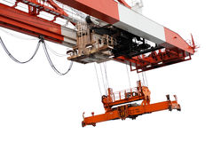 End of container crane beam and spreader, isolated. View of the outside end of the beam of a container handling gantry crane with the spreader empty taken at a Stock Image