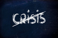 End of the crisis, time to grow. Crisis end writing on blackboard Royalty Free Stock Images