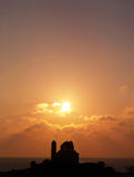 End of the day. The sun setting over a church in southern Cyprus stock photos