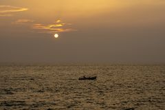 End of the day - Beautiful sunset with Fishermen returning stock photo