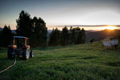 The End of the Day. In the end of the day, a farming machine is standing still while the sun is going down royalty free stock photography