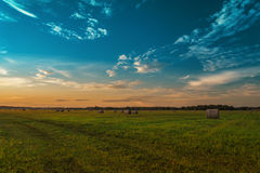 End of day over field with hay bale.  Royalty Free Stock Photos