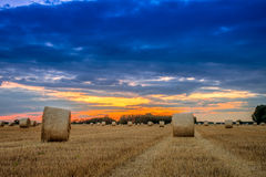 End of day over field with hay bale in Hungary- This photo make Stock Photo