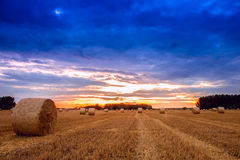 End of day over field with hay bale Royalty Free Stock Photo