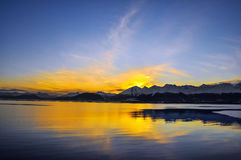End of the Day in Tierra del Fuego. The sun going down behind the mountains near Ushuaia, Teirra del Fuego Stock Photography