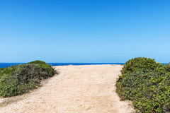 End of a dirt road to the sea. In Sardinia, Italy Stock Photos