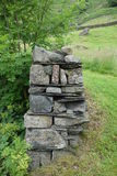 End of Dry Stone Wall. End of a dry stone wall in the Lake District, England, Cumbria, UK Stock Photography