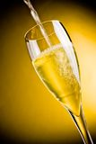 End of filling a champagne glass Royalty Free Stock Images
